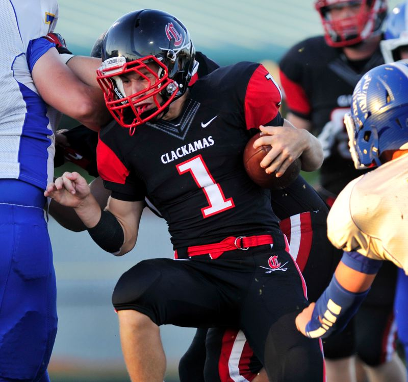 by: JOHN LARIVIERE - Clackamas junior Dan Sherrell (1), pictured in a preseason game with Newberg, was in form Friday night, as he rushed for 248 yards and six touchdowns to lead Clackamas in a 56-49 win over West Linn.