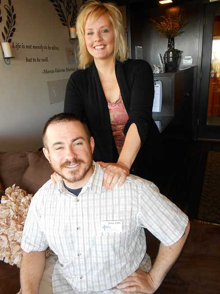 by: TIDINGS, REVIEW PHOTO: CLIFF NEWELL - One of the nice things about being married to Bree Ashby for her husband, Doug, is that he can receive an instant free massage. Doug holds up his end of handling business operations.