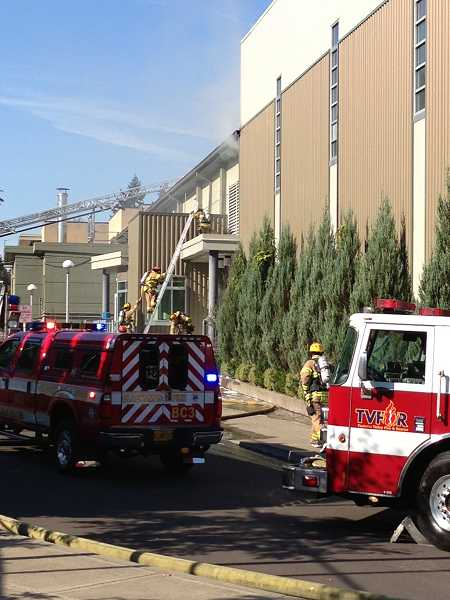 by: LORI HALL - Fire crews were still working to contain a fire at West Linn High School as of 3:45 p.m. Monday.