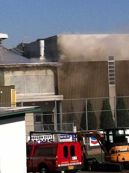 by: SUBMITTED PHOTO: JORI MONIHAN - Smoke rolled from the roof during the fire at West Linn High School on Oct. 8.