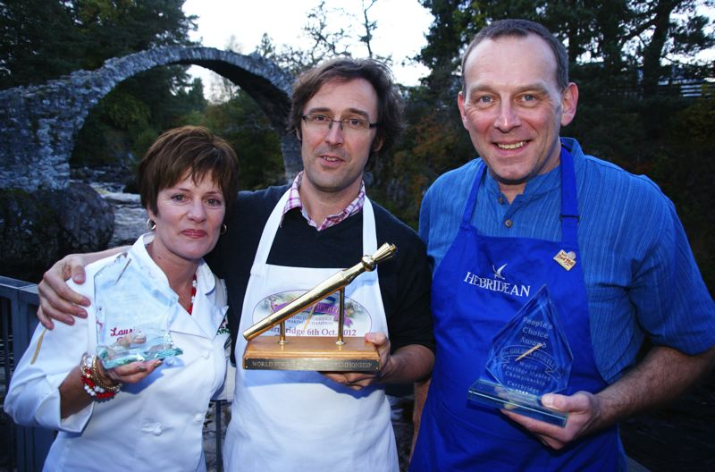 by: COURTESY OF THE 19TH ANNUAL GOLDEN SPURTLE COMPETITION - Laurie Figone, left, who competed for Bob's Red Mill in the Oct. 6 Golden Spurtle championship in Scotland, took home the Speciality Trophy. Benedict Horsbrugh, center, an organic baker, won the coveted Golden Spurtle award from former champ John Boa.