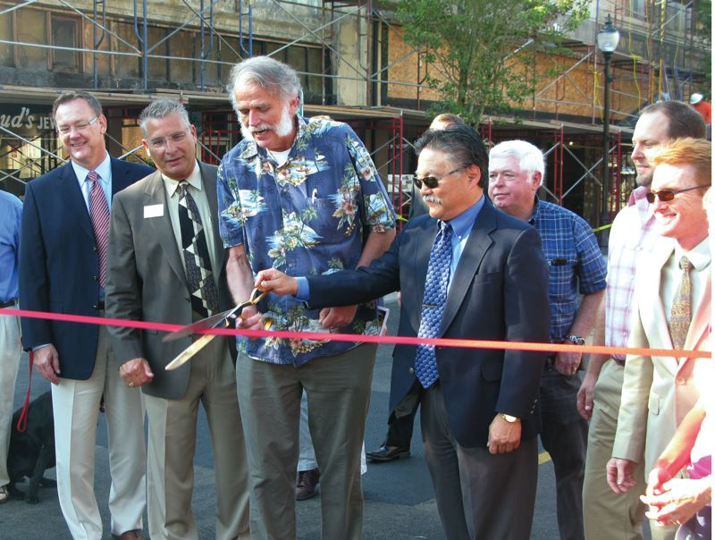 by: PHOTO BY RAYMOND RENDLEMAN - Oregon City leaders gather to cut the ribbon on Main Street last month in celebration of the completion of $2.5 million projects.
