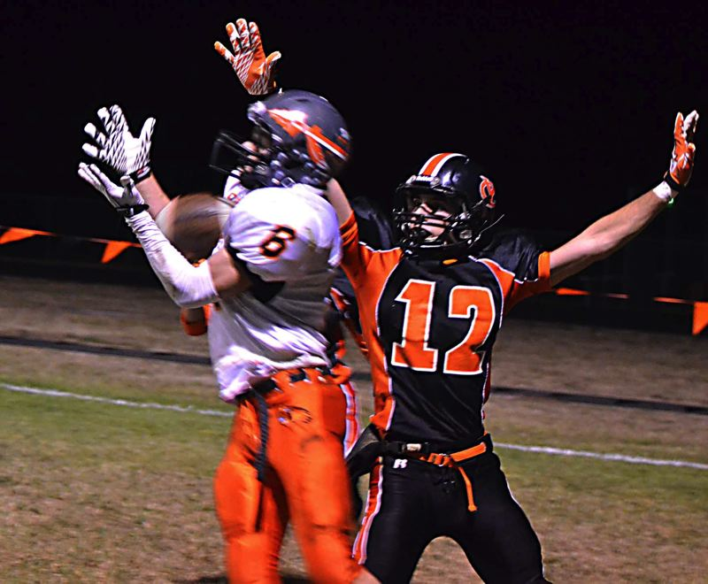 by: JOHN BREWINGTON - Paul Revis hauled in this catch for one of his four touchdowns in Friday's win over Yamhill-Carlton