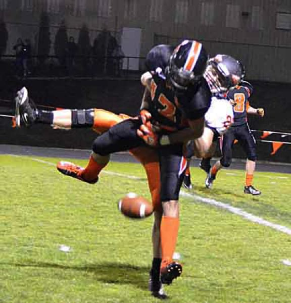 by: JOHN BREWINGTON - Scappoose's Matt Shoun broke up this YC pass attempt during Friday's game.