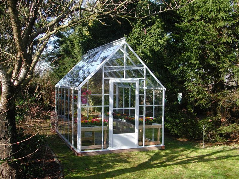 by: COURTESY PHOTO - Tempered glass walls are held together with an aluminum frame in The Cape Cod, a kit by Backyard Greenhouses of Dearborn, Mich. The 8-by-12 foot design ships in two to four weeks and sells for $5,150.