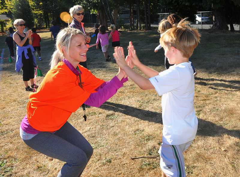 Fun run organizer Kristin McCoy encourages runners.