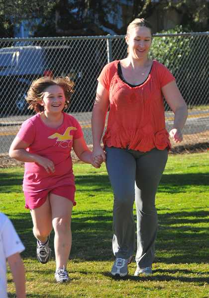 Sara Carstairs and her daughter, third-grader Nola, walk together.