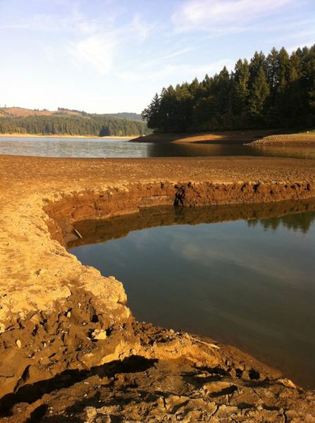 by: PHOTO COURTESY KEN BILDERBACK - As the waters of Hagg Lake have receded, the site of a dramatic September rescue where eight children nearly drowned, is now visible. A steep ledge is usually hidden by water during the peak recreation months.