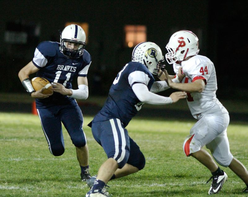 by: CHASE ALLGOOD.  - Banks Quarterback Garrett Markham gains some yards on quarterback keeper.