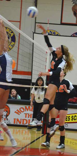 by: JOHN BREWINGTON - Scappoose's Lexine Loos goes high for a kill during last week's match with Banks.