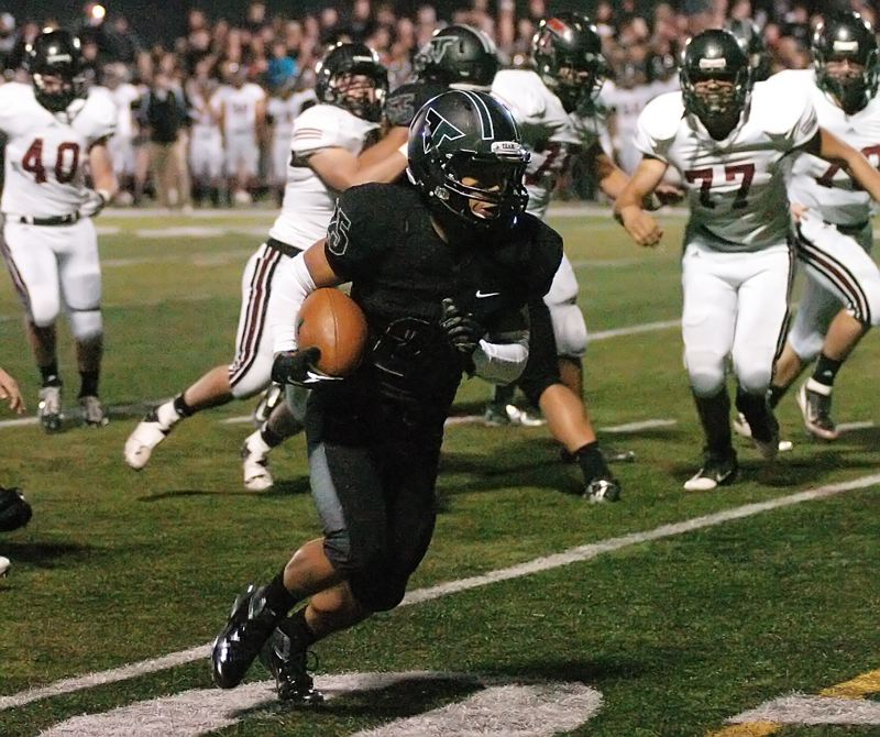 GREENE TO THE GOAL LINE -- Tigard senior Kaz Greene turns the corner on the way to scoring the third of his three touchdowns for the Tigers in their 41-0 win over Tualatin.