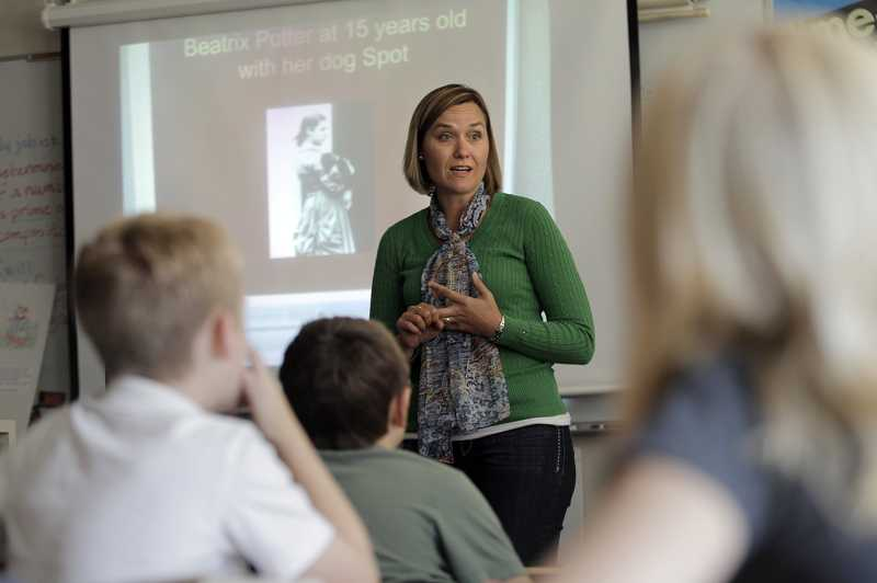 by: JAIME VALDEZ - Parent volunteer Hilary Bublitz discusses Beatrix Potter at Alberta Rider Middle School on Tuesday. The district's art lit program turns 30 years old this week and has grown from a handful of parent volunteers to more than 220.