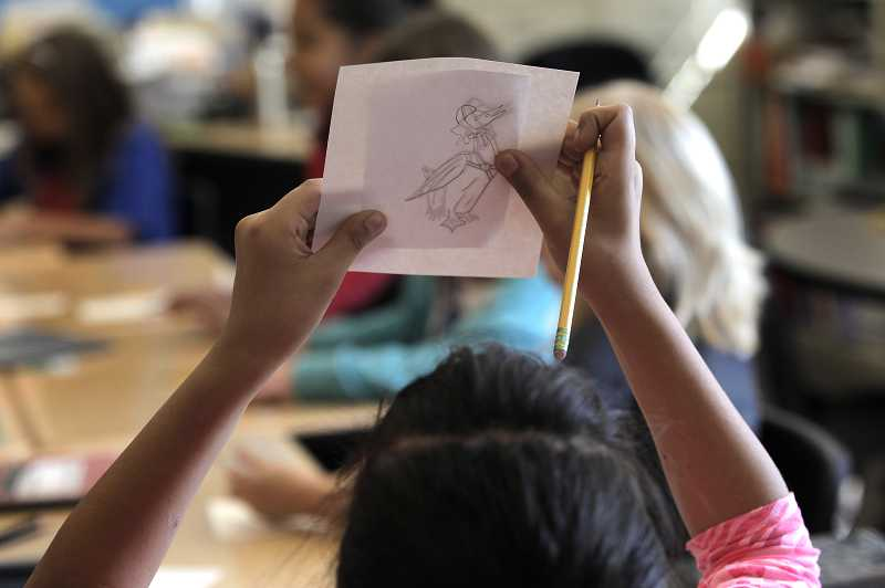 by: JAIME VALDEZ - Fourth-grader Lisbet Calderon traces Beatrix Potter illustrations at Alberta Rider Elementary School on Tuesday. The district's Art Literacy program turns 30 this year, thanks to support from PSOs and parent volunteers.