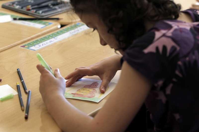 by: JAIME VALDEZ - Alberta Rider Elementary fourth- grader Clara Pane uses a water pen to enhance her water color drawing during art literacy class, Tuesday.
