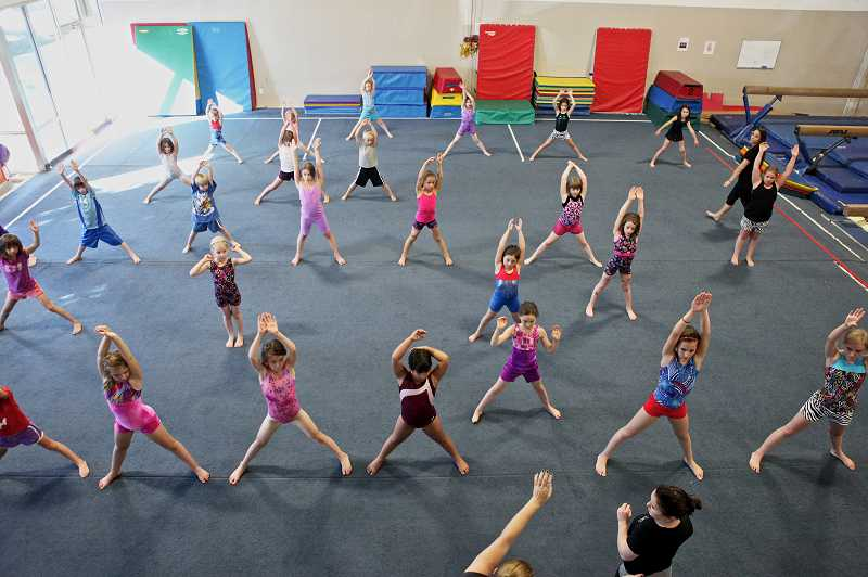 by: JAIME VALDEZ - Children in the 6 to 12 age group warm-up before gymnastics class at Oregon Gymnastics Academy.