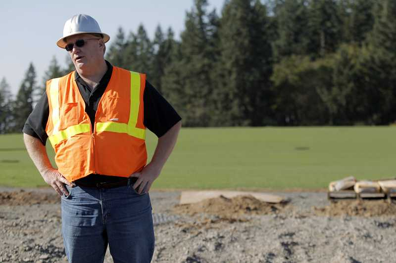 by: JAIME VALDEZ - Steve Gulgren, the Tualatin Hills Park and Recreation District superintendent of planning, stops to assess progress in the development of Paul and Verna Winkelman Park located near Cooper Mountain.