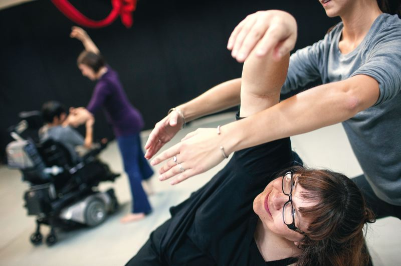 by: TRIBUNE PHOTO: CHRISTOPHER ONSTOTT - Dance is for everybody, say the folks who participate at Polaris Dance Theatre: In background, choreographer Yulia Arakelyan and Sarah Lakey (purple shirt); in foreground, Kathy Coleman and Sydney Skov (gray shirt).