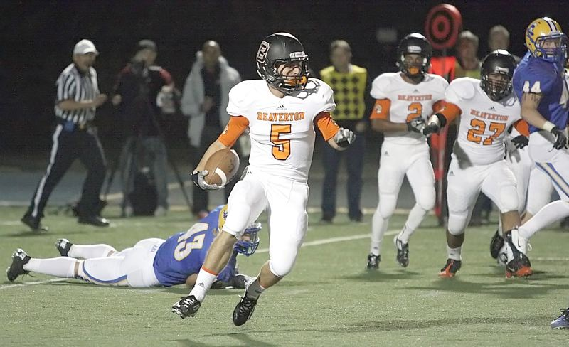 by: MILES VANCE - CUTTING UP - Beaverton senior Jaden Brands turns upfield on a kickoff return during his teams 42-22 Metro League loss to Aloha at Aloha High School on Friday night.