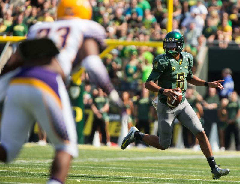 by: TRIBUNE PHOTO: CHRISTOPHER ONSTOTT - Oregon Ducks quarterback Marcus Mariota looks downfield against Tennessee Tech.