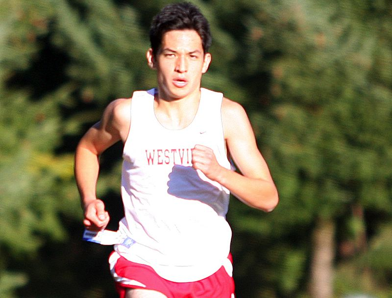 by: MILES VANCE - RUNNING STRONG - Westview senior RJ Morgan drives toward the finish line at the end of the 5-kilometer Metro League race at Hillsboro's Rood Bridge Park on Oct. 3.