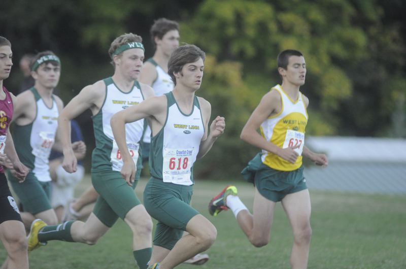 by: MATTHEW SHERMAN - The West Linn boys cross country team vies for position at the start of last week's race.
