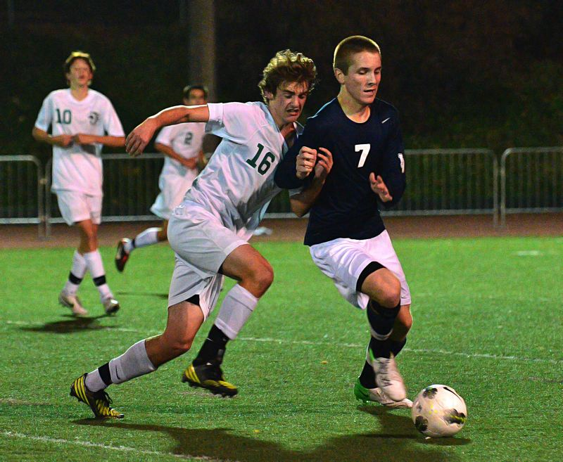 by: VERN UYETAKE - West Linn's Blake Hepburn makes a play on the ball during Tuesday's 2-1 loss to Lake Oswego.