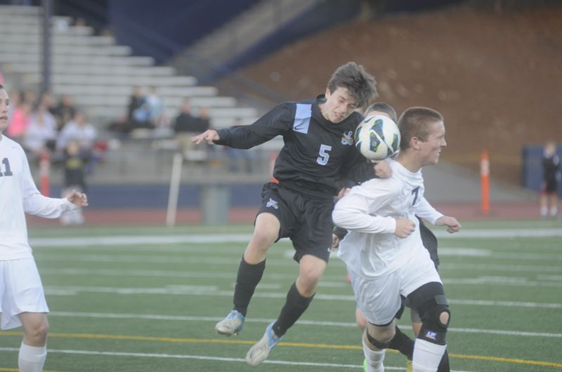 by: MATTHEW SHERMAN - Lakeridge's Nick Rooney tries to head the ball away from Lake Oswego's Alex Krenek during the Pacers' 3-1 victory last week.