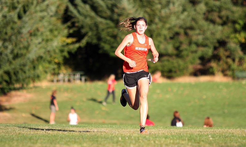by: MILES VANCE - HEADED FOR HOME - Beaverton sophomore Erin Gregoire left the rest of the field in her wake in winning the individual crown at the three-team Metro League meet at Hillsboro's Rood Bridge Park last week.