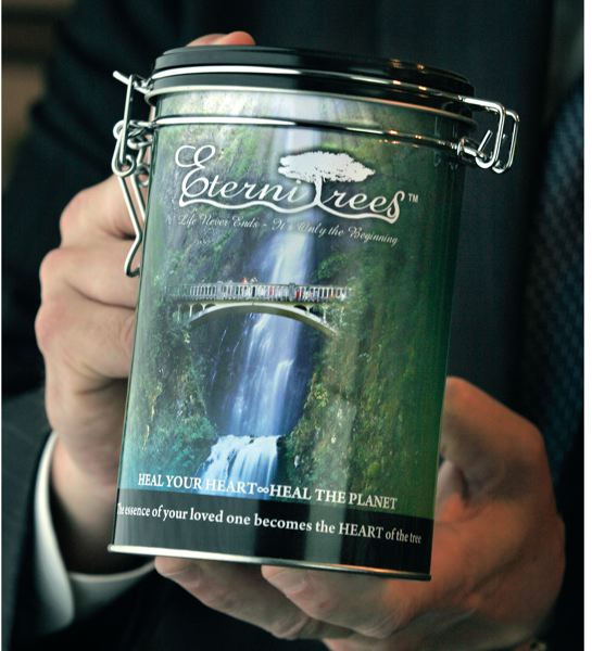 by: PAMPLIN MEDIA GROUP: JIM CLARK - Nicholas Hammerling used his photo of Multnomah Falls to grace a canister for ashes of cremated people.