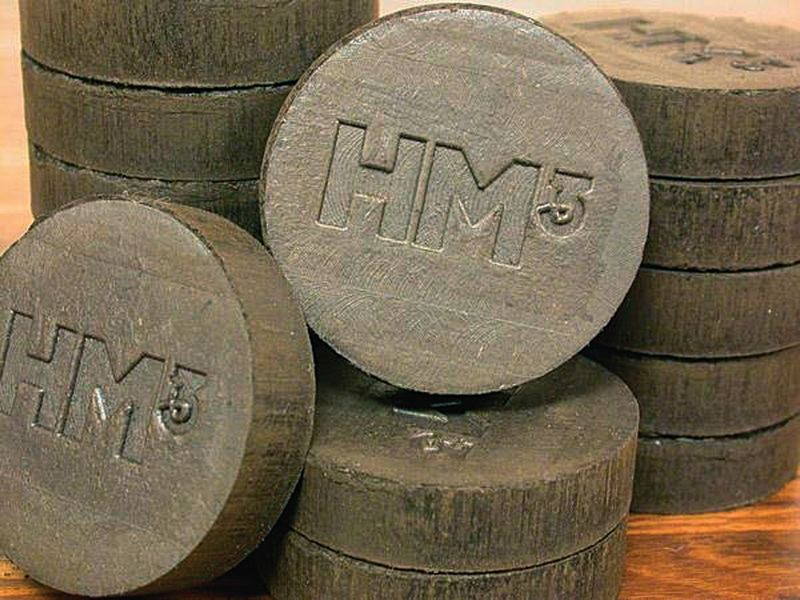 by: COURTESY OF HM3 - COURTESY OF HM3 A Gresham company hopes its briquettes made of biomass and resembling hockey pucks can be a clean-burning fuel substitute for coal at coal plants.