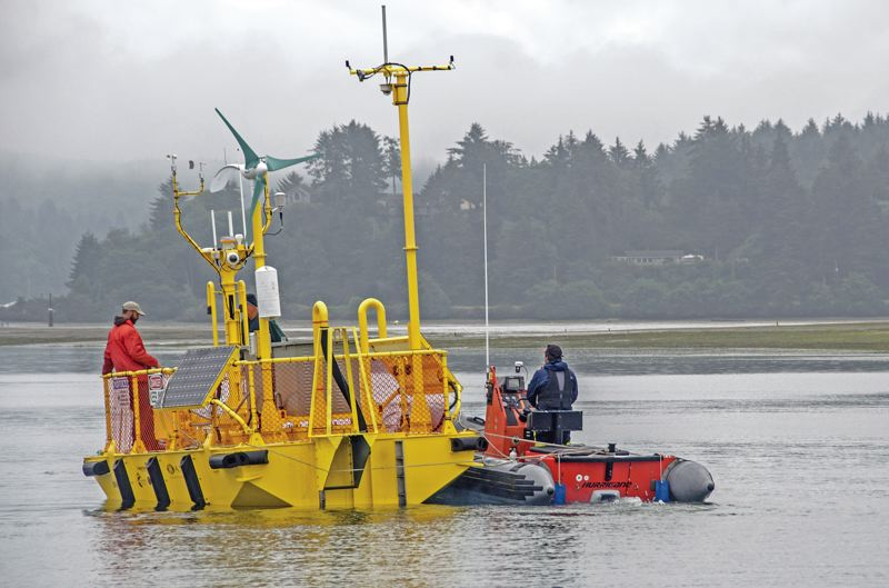 by: COURTESY OF PAT KIGHT, OREGON SEA GRANT - Oregon State University's Northwest National Marine Renewable Energy Center deploys its new wave energy testing platform, the Ocean Sentinel, two miles offshore from Yaquina Head in August.
