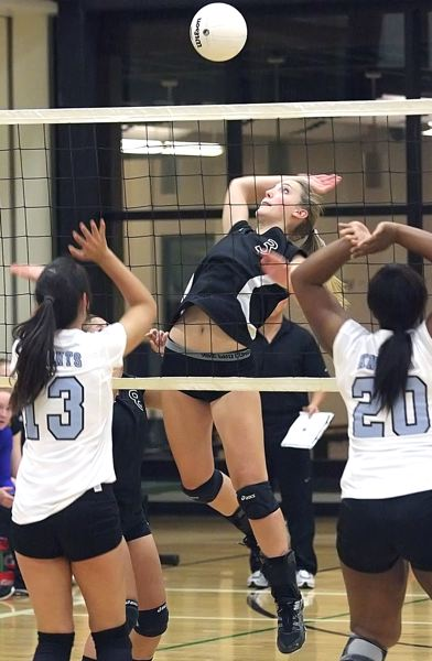 by: MILES VANCE - FLYING HIGH - Valley Catholic junior Madeline Henningsen catches air while making an attack during her teams three-game sweep of De La Salle on Tuesday night in Portland.