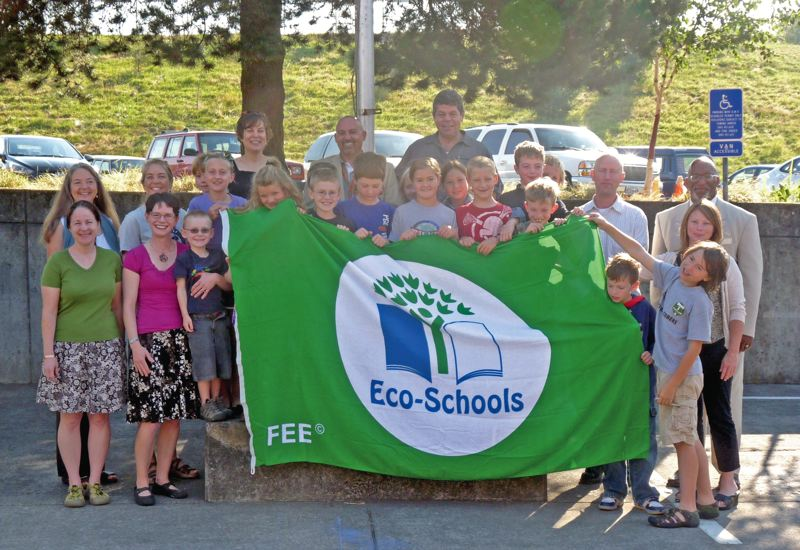 by: SUBMITTED PHOTO - Mary Rieke students and faculity proudly display their 'Green Flag'