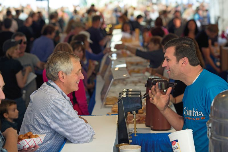 by: TRIBUNE PHOTO: CHRISTOPHER ONSTOTT - Charlie Hales talks with voter Telly Gjinos at the Greek Festival on Saturday. Both candidates are looking to sway the 37 percent of undecideds in the race.