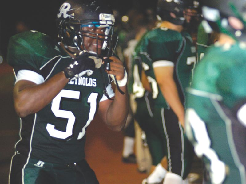 by: THE OUTLOOK: DAVID BALL - Reynolds lineman Theo Samue prepares to take the field.
