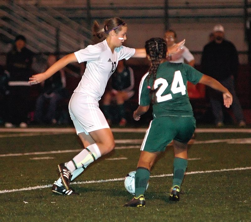by: KRISTOPHER ANDERSON - Haley Kern pushes the ball up the field.