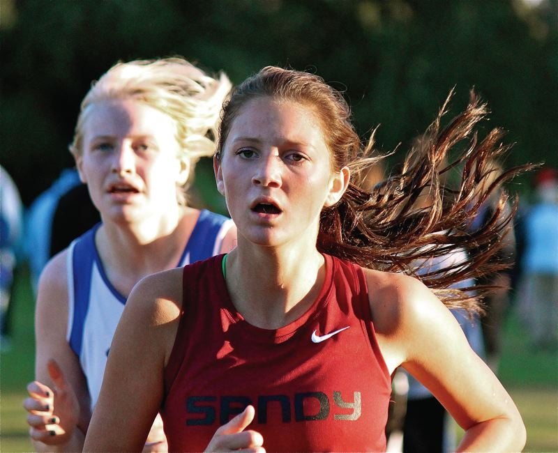 by: CONTRIBUTED PHOTO: PATRICK FREEMAN - Sandy girls cross country runner Aspen Weller runs during the Northwest Oregon Conference dual meet.