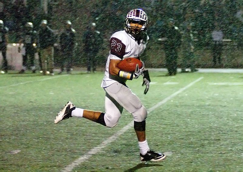 by: DAN BROOD - RUNNING IN THE RAIN -- Sherwood senior Cristian Morris is all alone as he sprints to the end zone on a 33-yard touchdown run.