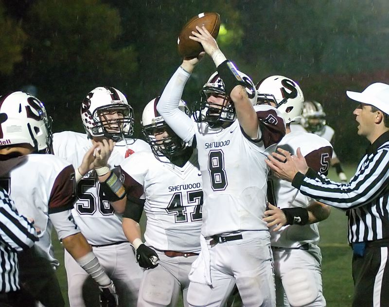 by: DAN BROOD - I GOT IT -- Sherwood senior Joseph Balfour (8) holds up the ball after recovering a Wilsonville fumble in the Bowmen's 35-14 win.