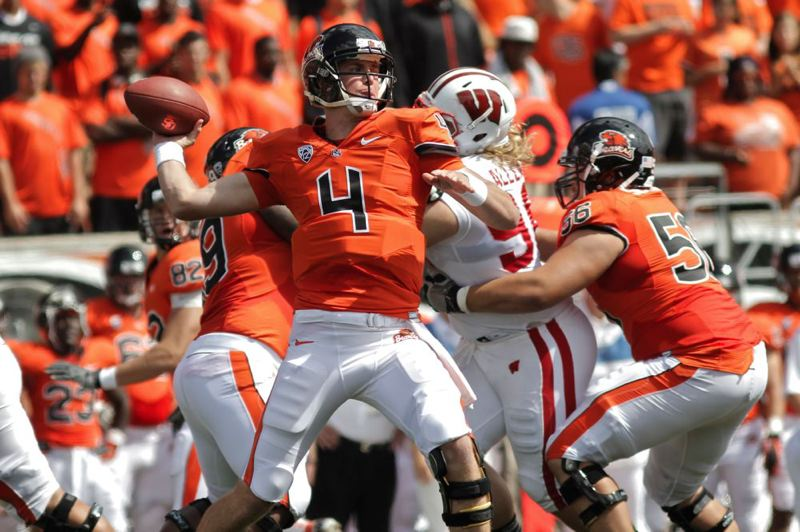 by: TRIBUNE PHOTO: JAIME VALDEZ - Oregon State quarterback Sean Mannion, passing in the season-opening win over Wisconsin, says he has a good chance of returning from knee surgery in time for the Beavers' Oct. 27 game at Washington, and hasn't ruled out playing Saturday at home against Utah.