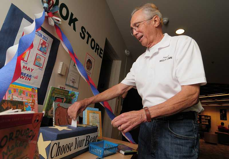 by: REVIEW, TIDINGS PHOTO: VERN UYETAKE - West Linn Mayor John Kovash casts his ballot in the Best Bear Election.