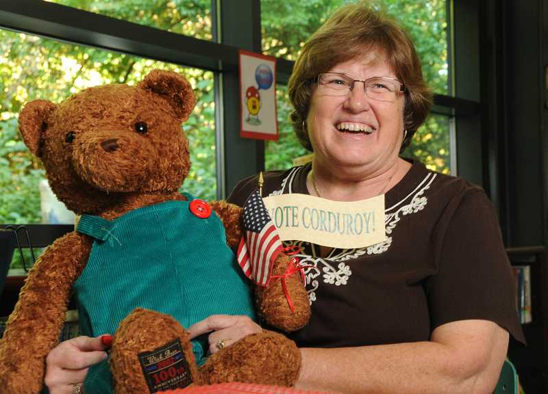 by: REVIEW, TIDINGS PHOTO: VERN UYETAKE - West Linn librarian Julie Blake took the teddy bear from her grandchildren's room and handmade his little outfit.