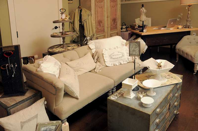 by: REVIEW, TIDINGS PHOTO: VERN UYETAKE - The shabby chic space offers pillows, handmade linens, candles, jewelry and more.