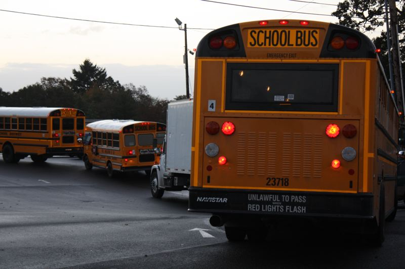 by: KATIE WILSON - St. Helens School District buses line up.