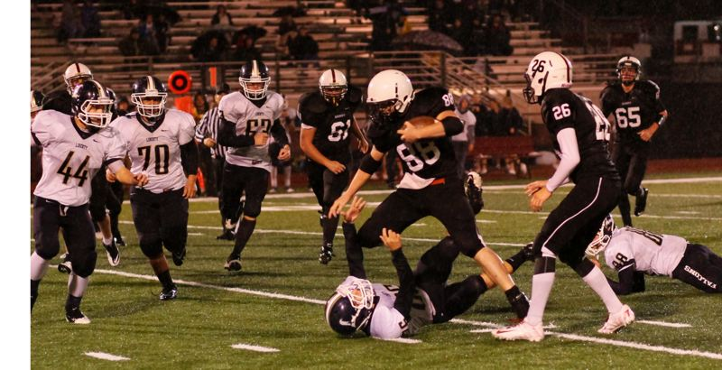 by: JULI CHURCHILL - Sandy receiver Andrew Funk breaks tackles as he runs up the field