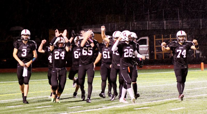 by: JULI CHURCHILL - Sandy celebrates after last Friday's win over the Liberty Falcons