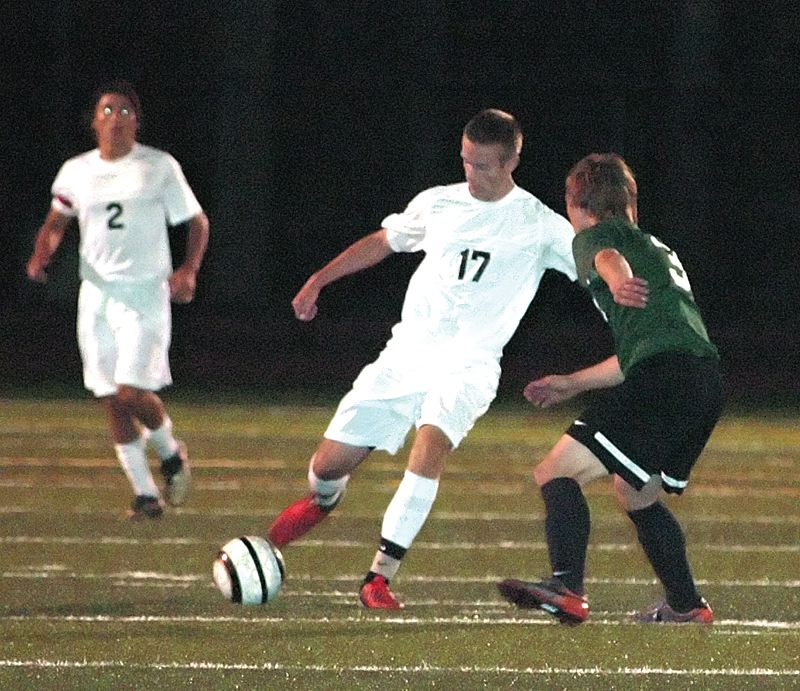 by: KRISTOPHER ANDERSON - Wyatt Edwards takes aim during Sandy's 3-1 overtime loss to Putnam last Thursday