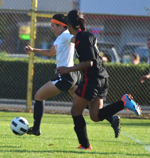 by: JOHN BREWINGTON - Ariel Viera took the ball right to the net for her 100th career goal last Wednesday in the first nine minutes of Scappoose's match with Tillamook.