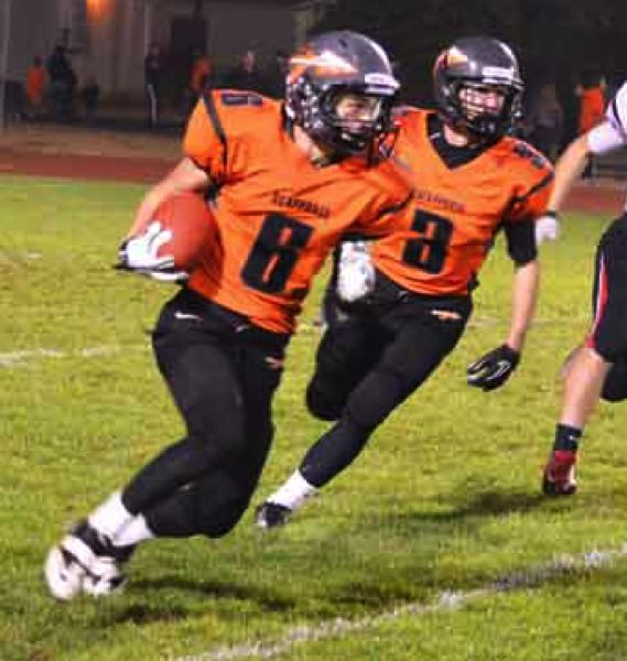 by: JOHN BREWINGTON - Scappoose's Paul Revis (6) gets an escort from Kyle Kramer during last Thursday's game with Tillamook. Revis had four pass receptions for scores and threw to Kramer for another.