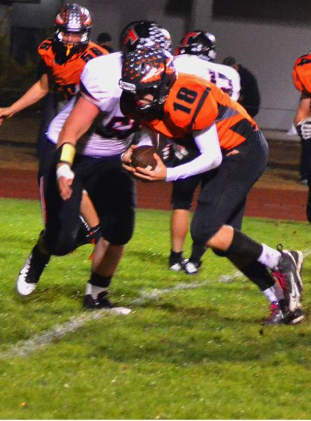 by: JOHN BREWINGTON - Scappoose's Taylor Loss punched the ball over for a touchdown during last Thursday's game with Tillamook. He also had four TD passes to Paul Revis.